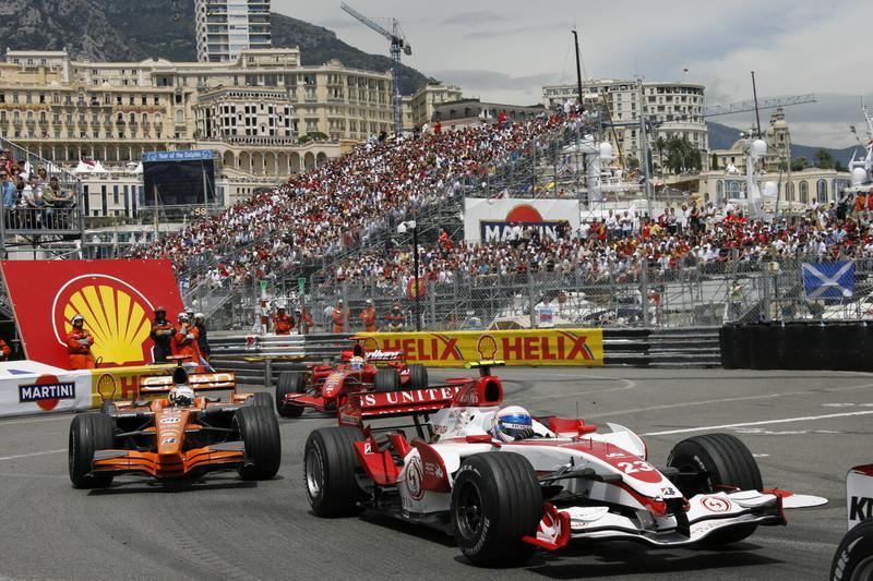 Formula 1 race cars hug the corners at the famous Monaco Grand Prix.